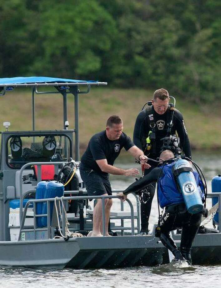 Members of the Precinct 1 Constable's Office Dive Team search an area of The Woodlands Waterway Tuesday. / The Courier