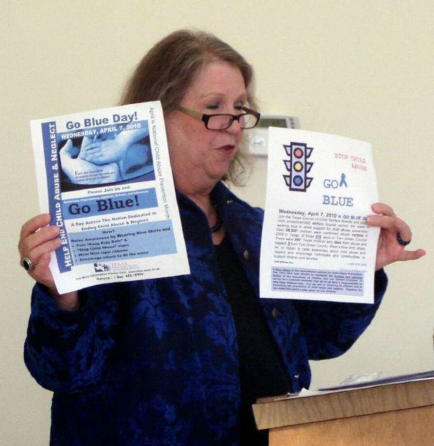 Child Welfare Board member Dorothy Bottos shows two fliers to members of the Waller County Commissioners Court last Thursday while promoting April as Child Abuse Prevention Month.