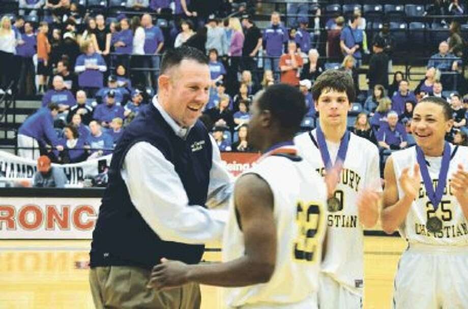 Westbury Christian head basketball coach Russell Carr, shown here giving his TAPPS 4A state championship team their medals after they won the state title for the fourth consecutive year in February, will be coaching a team in the third annual Texas Shootout All-Star game May 11 in Waco.