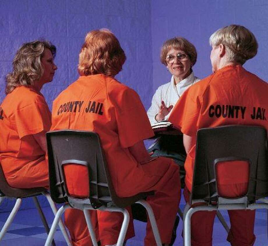 A CrossNet Ministry volunteer counsels female prison inmates.