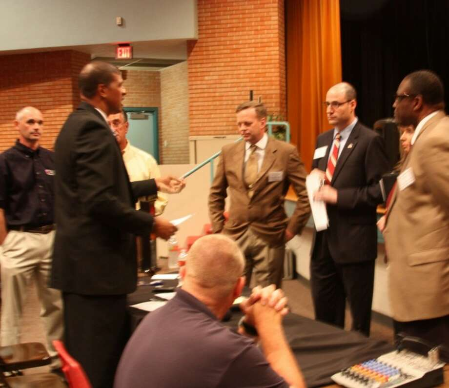 The Pearland Police Officer's Association and the Pearland Chamber of Commerce hosted a candidate forum Thursday (April 26) at the C.A. Nelson Auditorium. Candidates and organizers met briefly before city council candidates took the stage. Photo: KRISTI NIX