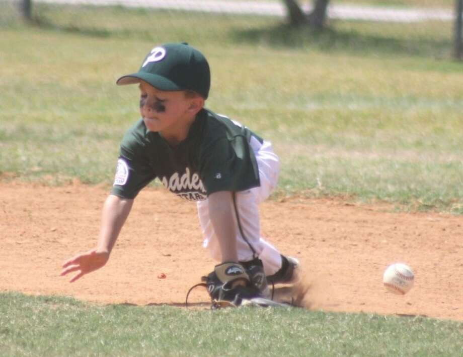Pasadena shortstop Jacob Hoesel can't quite glove this low liner during a Pony Directors Tournament for the 5 and 6-year-old teams at Strawberry Park Sunday afternoon. Hoesel and his teammates met another Pasadena squad that resulted in a 25-25 tie. Strawberry Park will be humming with Pony Baseball postseason action this weekend. For the first time ever, the city will be hosting a Shetland (5-6s), a Pinto (7-8s) and Mustang (9-10s) tournament. The 9 and 10s tourney will be the first step towards a World Series. Photo: Robert Avery