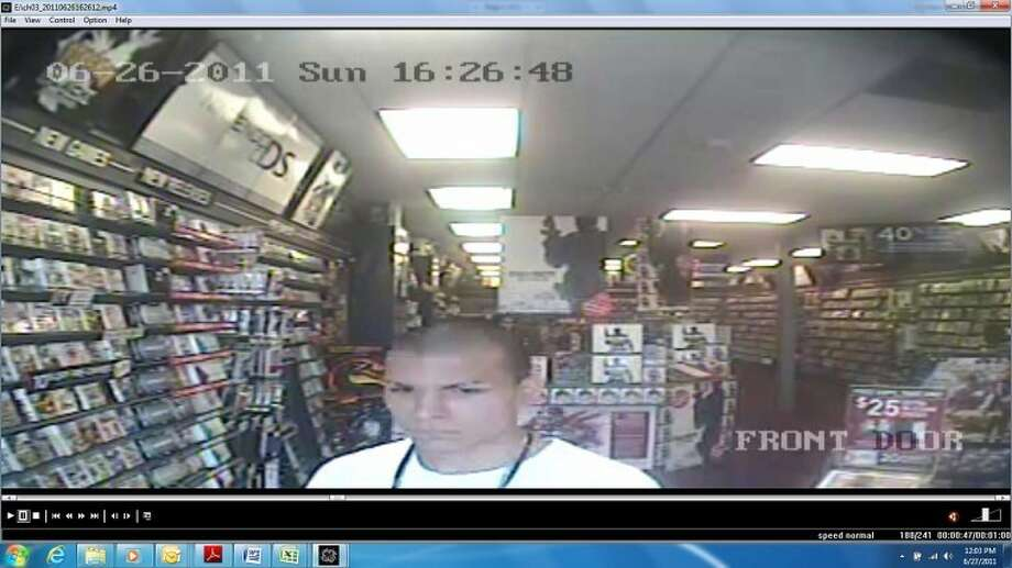 This video still from a Game Stop store in Porter shows a man believed to have robbed the store around 4:24 p.m. Sunday. Montgomery County Sheriff's detectives and Conroe Police detectives believe the man also may be responsible for the robbery Tuesday night of a Pizza Hut in Conroe.
