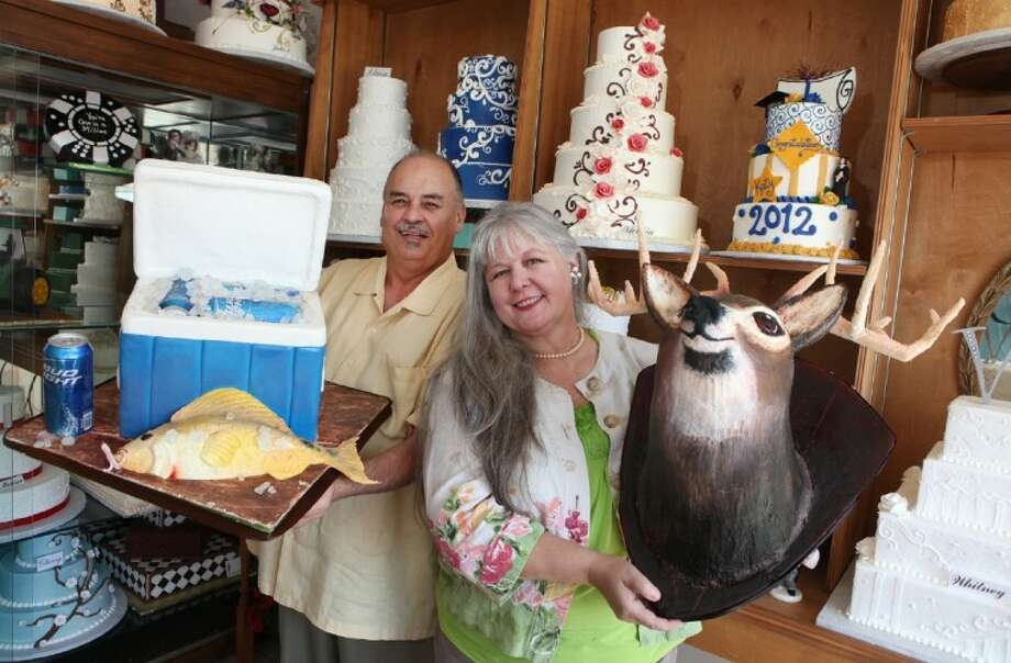 ( L to R)Ron and Julie Clifton with some of their more unusual cakes at their bakery, Julies Cakes in Missouri City. (Photo by Alan Warren) Photo: Photo By Alan Warren