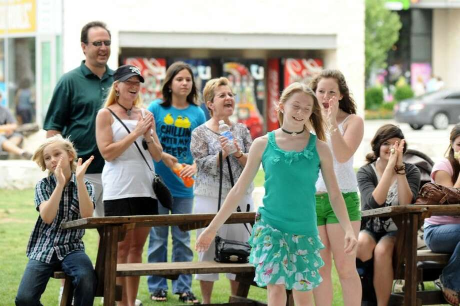 """Cayce Johns' family cheers as her name is called announcing her to be a finalist in the Let Freedom Sing talent contest and selected to sing """"America the Beautiful"""" during Pearland's Fourth of July celebration."""