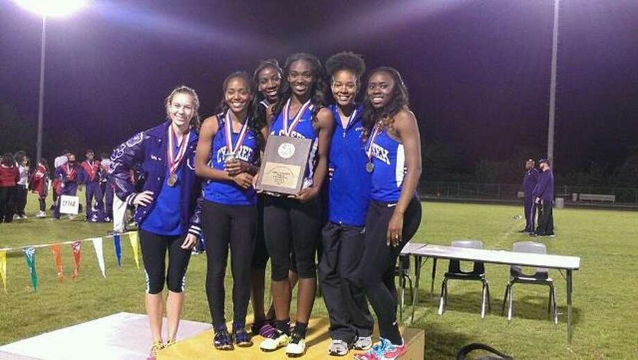 The Cy Creek girls' track and field team is pictured holding the District 17-5A championship plaque after Thursday's meet at Cy Ridge High School. Photo: Submitted Photo