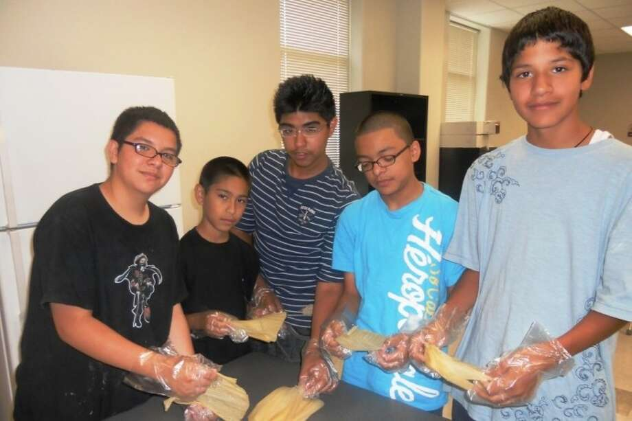 Students show their expertise at tamale preparation in the Southmore 21st Century summer program. Photo: For The Citizen