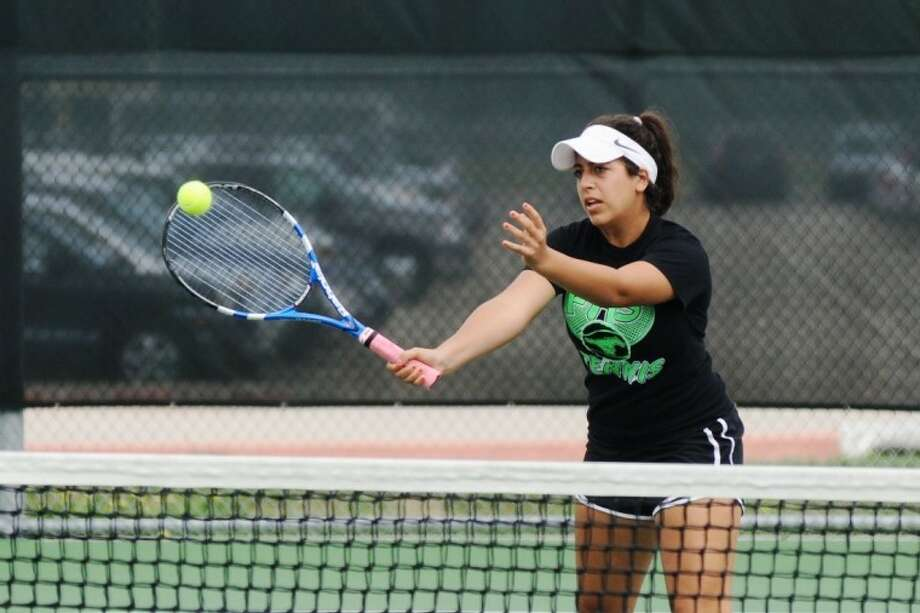 Friendswood's JoAnn Karam will try to bring home a mixed doubles state title with partner Kent Tollette next week at the World of Tennis at Lakeway. Photo: KIRK SIDES