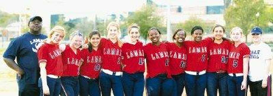 The Lamar girls softball team may have just 10 players, but the Redskins began this week with a 19-7 record and stood at 7-1 in District 20-5A play. Led by head coach Melvin Watkins, left, the Redskins have basically secured a playoff spot with five games to go, including a potential season finale against Bellaire for the District 20-5A championship.