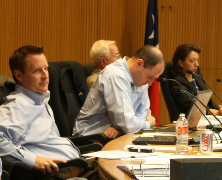 Around 1 a.m. City Councilmembers appeared weary from the long hours of discussion. From left: Councilmembers Steve Saboe, Scott Sherman, Mayor Tom Reid and Felicia Kyle. Photo: KRISTI NIX