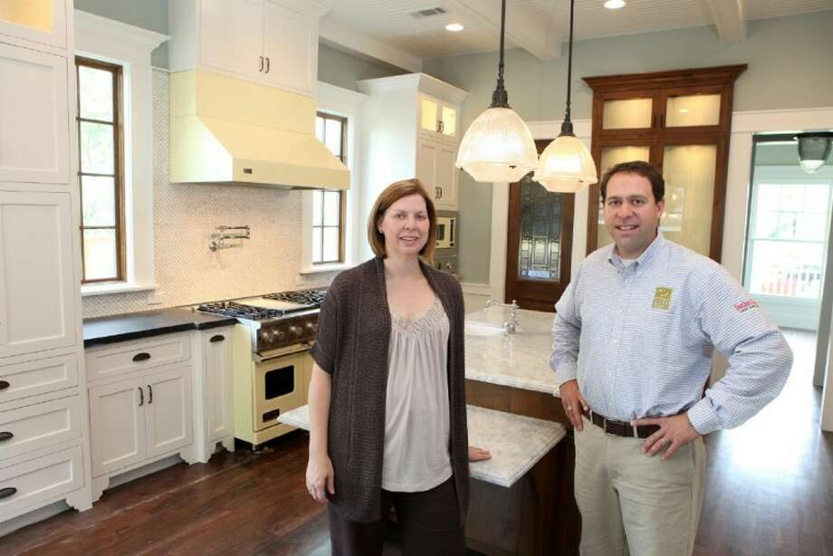 (L to R)Sarah Lavine-Kass and her brother, Benjamin Lavine of Stone Acorn Builders, inside their Southern Living Showcase Home under construction in Bellaire. (Photo by Alan Warren) Photo: Photo By Alan Warren