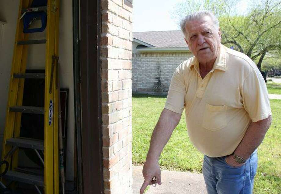 Barry Griffin points out places around his house that need repair on Wednesday.