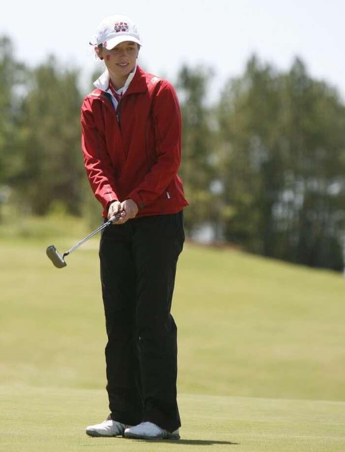The Woodlands' Kelly McGovern watches a putt on the 18th hole Thursday at Raven Nest Golf Club in Huntsville.
