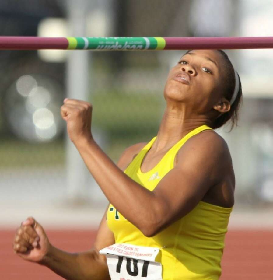 Sadalia Ellis is headed to Austin for the state track meet in two weeks. She was there a few months ago as Cy Falls' point guardon the girls' basketball team. Photo: Jason Fotchman