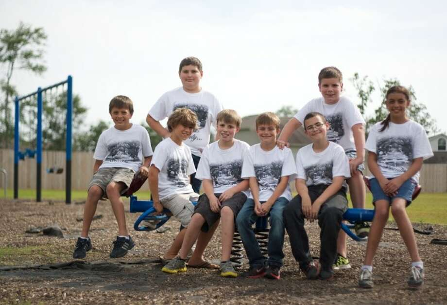 A group of children have come together to help raise funds to rebuild a playground which was destroyed by wildfires in Magnolia. Photo: Staff Photo By Eric S. Swist