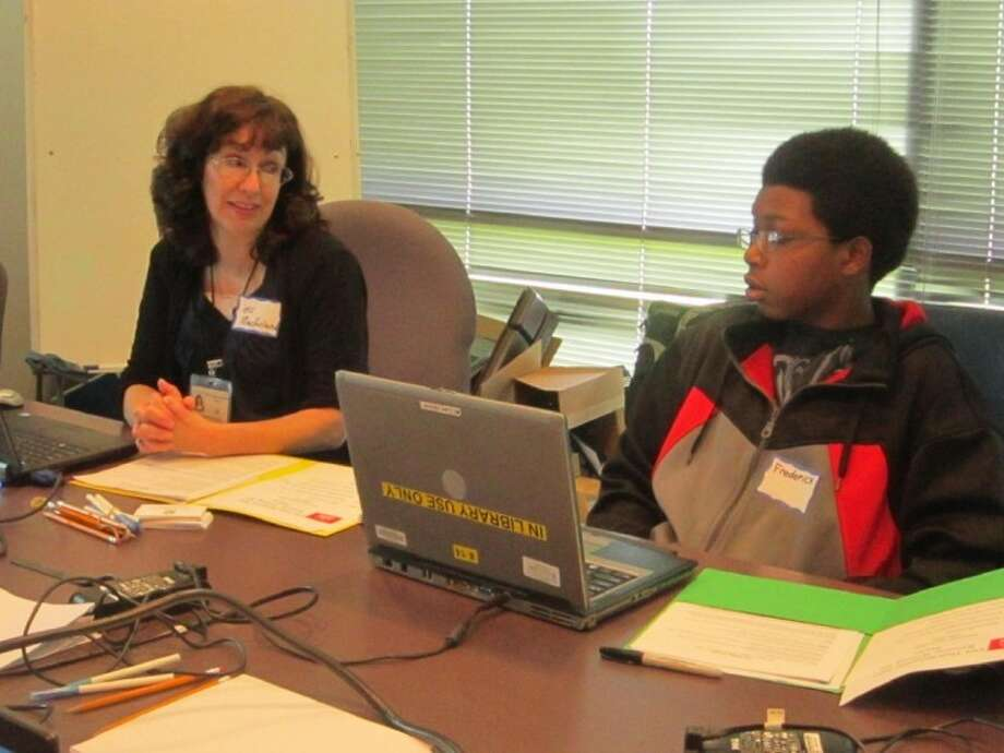 Missouri City librarian Charline Macfarlane, left, speaks to Missouri City Middle School eighth grader Frederick Merritt during a resume-building workshop.