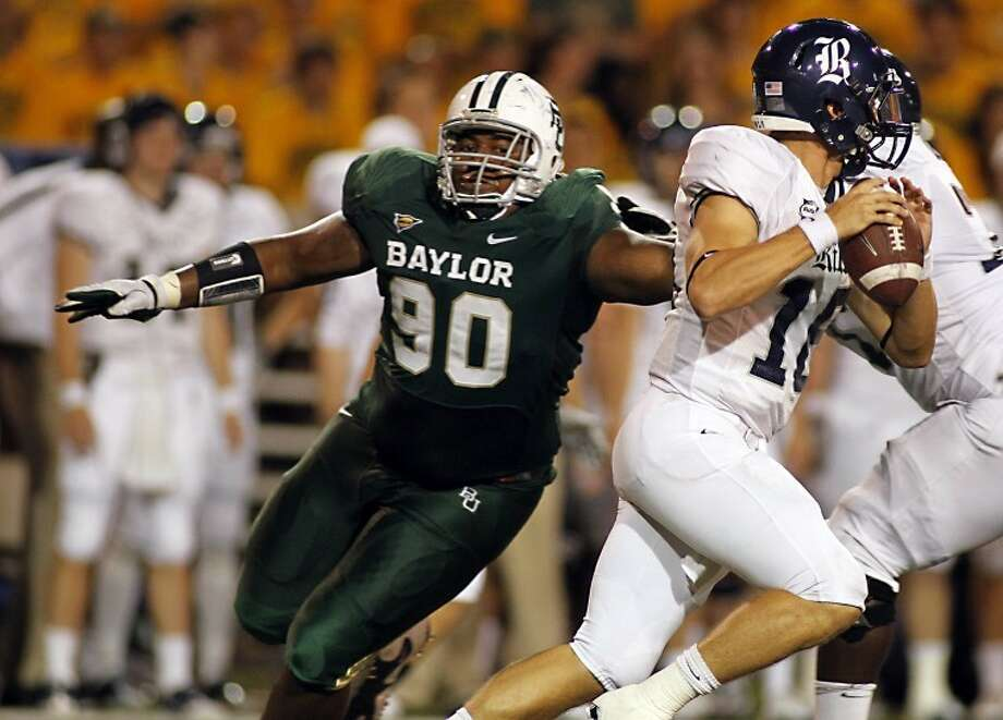 Strake Jesuit graduate Nicolas Jean-Baptiste recorded 8 1/2 tackles for loss and four sacks for Baylor during his senior season. The defensive tackle was signed by the Baltimore Ravens as an undrafted free agent. Photo: Robert Rogers/Baylor Athletics