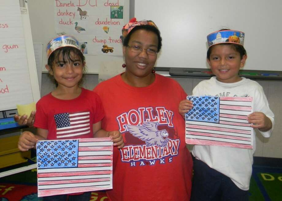 Students Janette (left) and Diego (right) celebrated Independence Day with their ESL teacher, LaTosha Dunson.