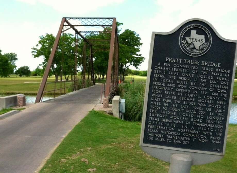 An historic iron truss bridge connects the first and eighteenth holes at Battleground Golf Course in Deer Park. Photo: RICHARD TEW