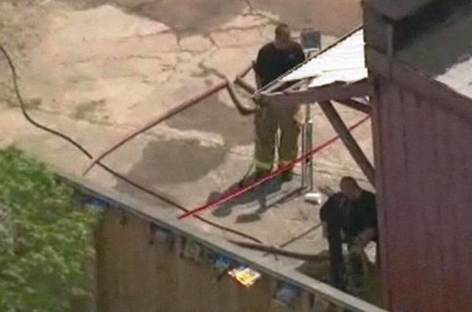 Firefighters on the scene of a suspicious blaze Friday morning in the 1200 block of Richmond Ave. where a body was later discovered. Photo: ABC-13