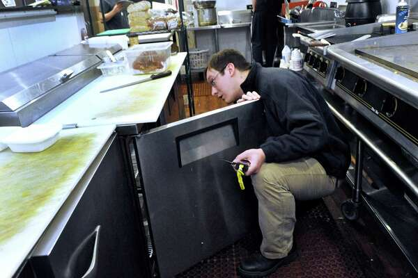 Ryan Boggan, 28, of New Milford, public health inspector for the city of Danbury, during an inspection of a local restaurant , Monday, March 7, 2016.