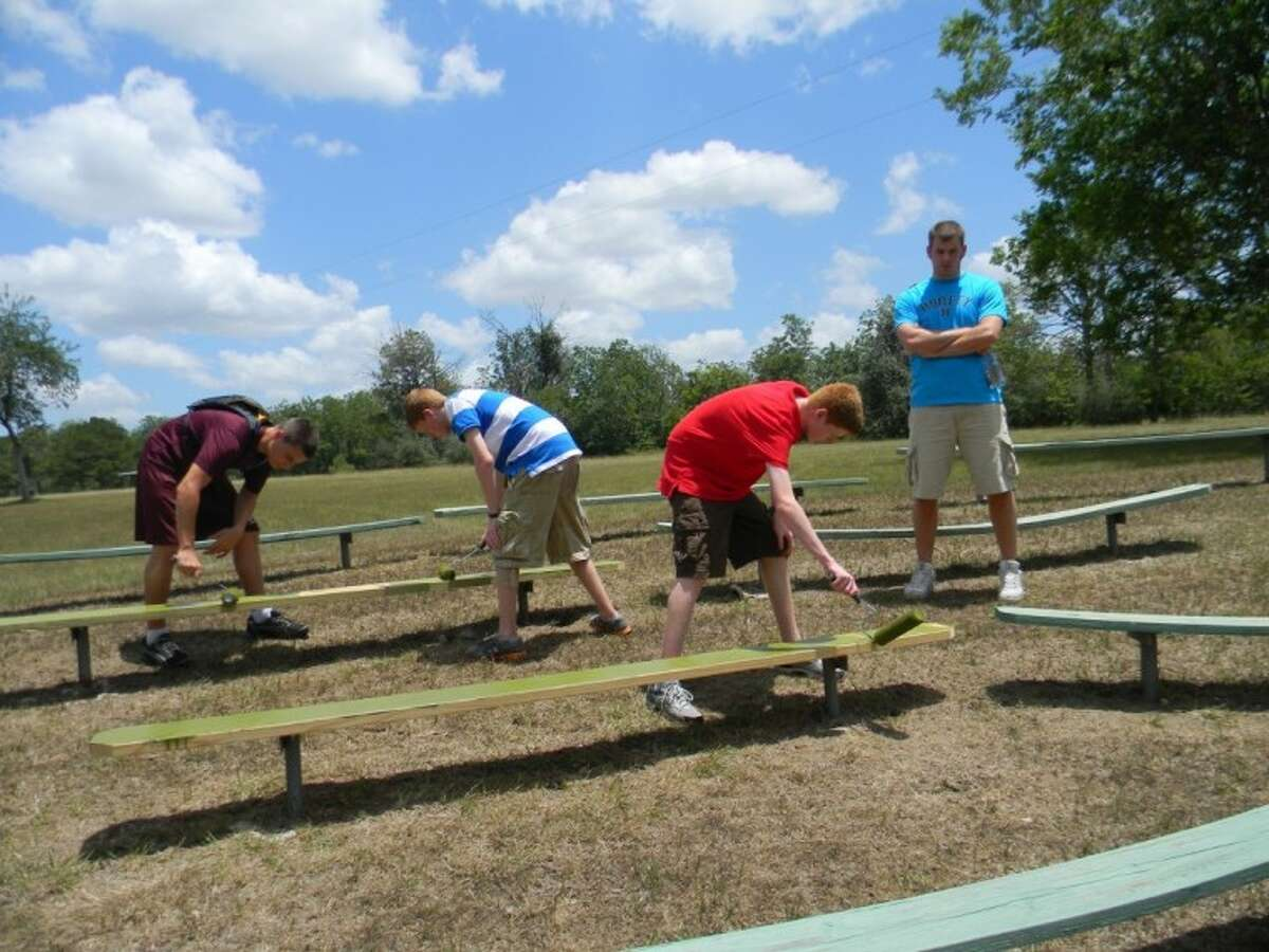 Working hard on a service project are Mason Ogg, Atascocita High School; Alexander Hales, Summer Creek High School; Joshua Hales, Summer Creek High School; and youth leader Tyler Wharton.