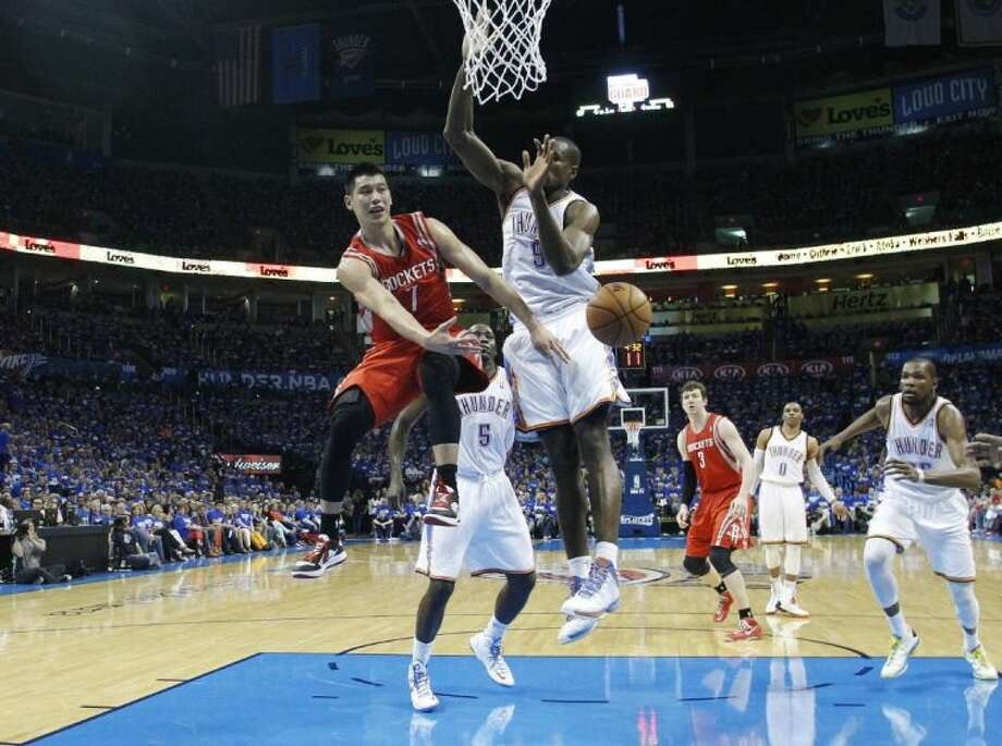 Houston Rockets guard Jeremy Lin passes off in front of Oklahoma City Thunder forward Serge Ibaka during Game 1 of a first-round playoff series Sunday in Oklahoma City. The Thunder won 120-91, and then held off the Rockets in Game 2, 105-102.