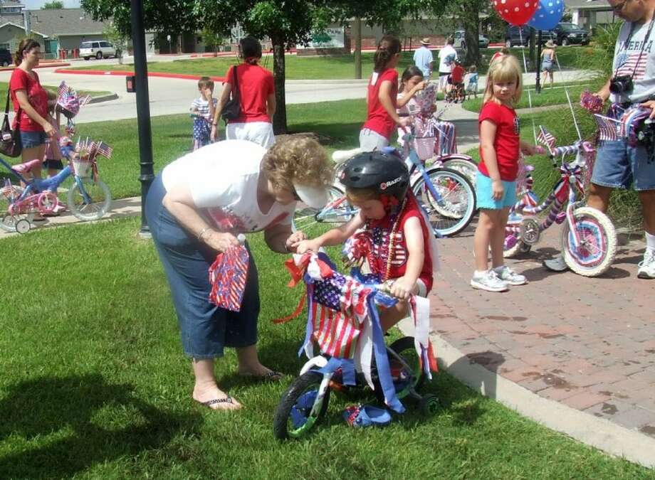 Katy Heritage Society 2011 Independence Day Children's Bike and Tike Parade was a family with parents and grandparents helping the little ones show off their patriotic pride. Photo: KEVIN KOLOIAN