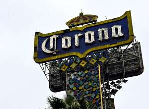 A logo of Mexican beer Corona is seen in Mexico city on September 28, 2016.  Belgian-Brazilian brewer AB InBev savoured its status as the global leader in the beer industry after investors approved Wednesday its buyout of British rival SABMiller. Shareholders in SABMiller -- currently the producer of Foster's, Grolsch and Peroni lagers -- overwhelmingly approved $103-billion (92-billion-euro) takeover from the maker of Budweiser, Corona and Stella Artois. / AFP PHOTO / RONALDO SCHEMIDTRONALDO SCHEMIDT/AFP/Getty Images