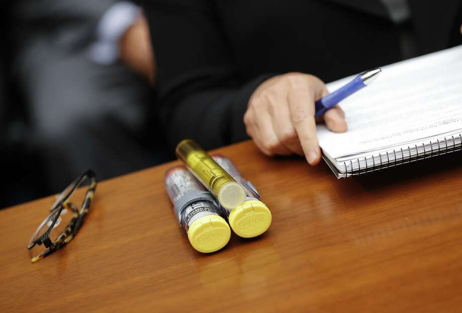 Mylan classified its lifesaving EpiPen as a generic drug, which requires lower payments to states. Photo: Pablo Martinez Monsivais, Associated Press