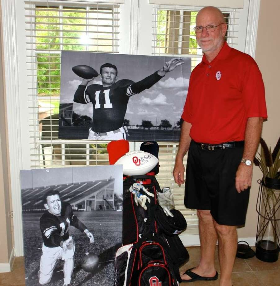 Dan Boz of The Woodlands poses with enlarged pictures of former OU quarterback and UT football coach Darrell Royal. The pictures will be auctioned off to raise money for a scholarship in Royal's name. Photo: Staff Photo By Jon Poorman