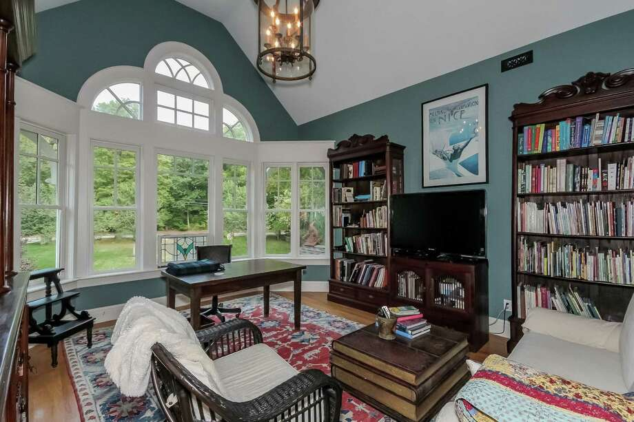 Family room: The two-story family room has the home's only working fireplace; others are strictly decorative. Photo: Contributed / Contributed Photo / Fairfield Citizen