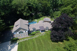 House aerial view: The contemporary-style colonial house at 7 Wedgewood Road was constructed as a ranch in 1969 but underwent a huge transformation three years ago.