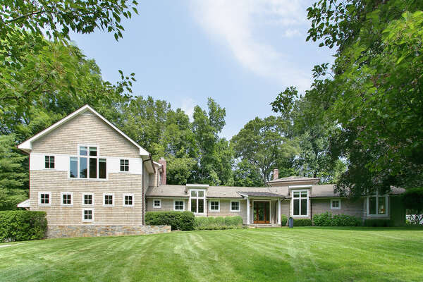 Front street view: The once-ranch-style house was completely renovated and expanded in 2013 to the 4,958-square-foot colonial contemporary it is today.