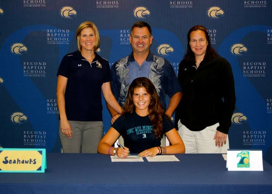 Second Baptist senior Christine Kharkevitch signed a tennis scholarship with UNC-Wilmington, celebrating the achievement with (from left)SBS tennis coachesSusy and Derik Crosser and Sue Berg, women's athletic coordinator. Photo: Second Baptist School