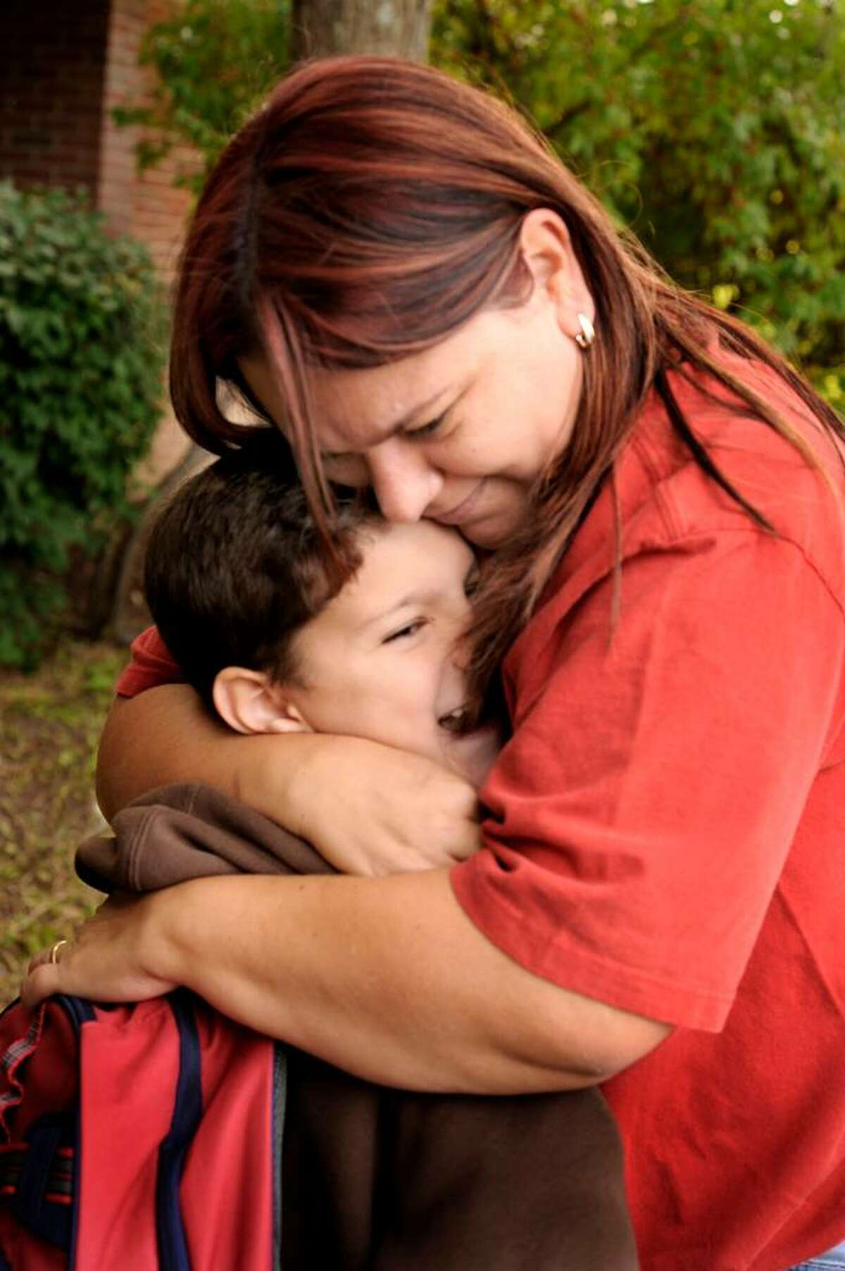Antonio Goncalves gets a goodbye hug from his mom,Patricia, before entering King Street Primary School in Danbury for his first day in first grade on Sept. 3, 2009.