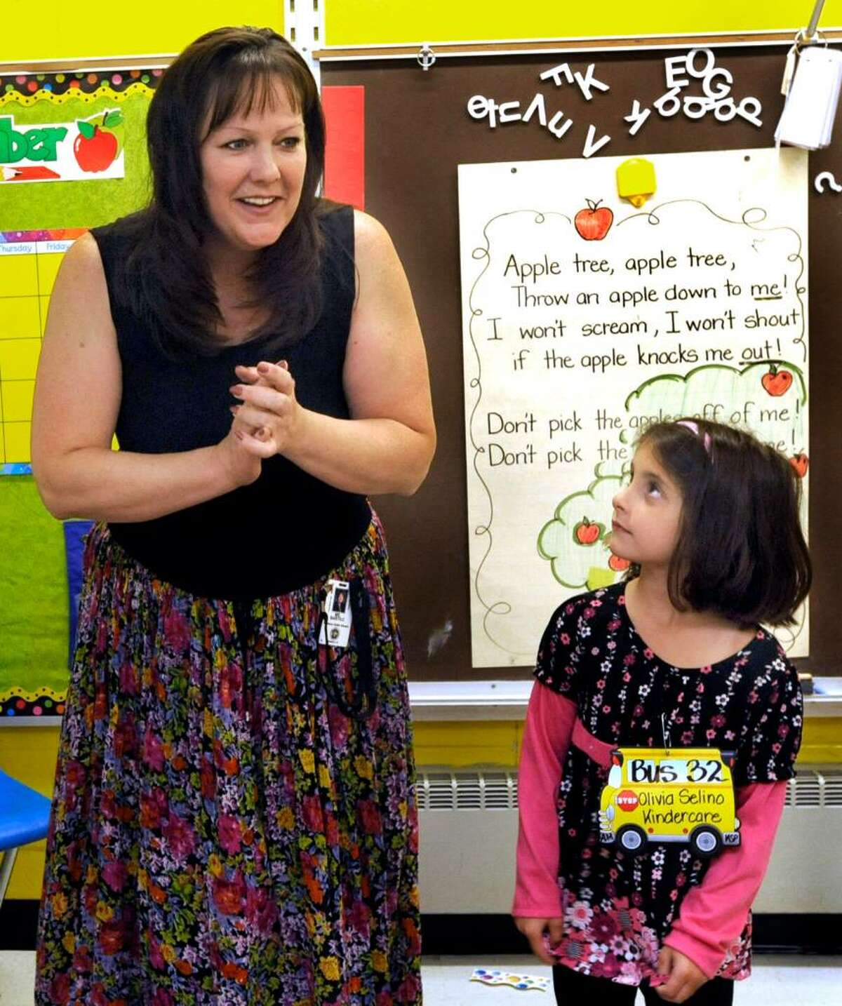 Kindergarten teacher Charlene Bartko, whose birthday coincides with the first day of school, greets her class at King Street Primary School in Danbury on Sept. 3, 2009. Olivia Selino, right, pays rapt attention.