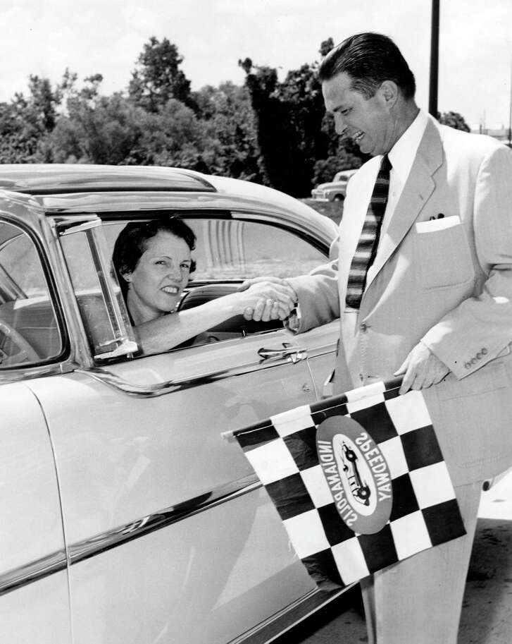 """Houston Mayor Roy Hofheinz congratulates Mrs. Ted Clayton, 807 42nd St., on being the first """"taxpayer to use"""" the newly opened Waugh Drive at Memorial interchange, July 8, 1955.   When the interchange opened, it was to help alleviate traffic at Buffalo Drive (now Allen Parkway) and Shepherd and Shepherd at Memorial. On this day though, few drivers used it and issues with the signal lights at these intersections made for a traffic headache. Driving two blocks took 15 minutes.   When the interchange opened, Hofheinz said it """"should meet the traffic needs for the next 20 years."""""""