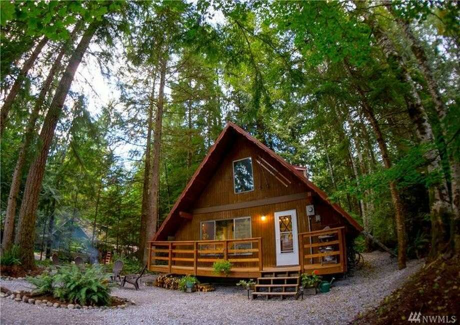 This cute little cabin in Glacier is listed for $180,000. Built in 1974, it features slate floors, a newer metal roof and custom tile work. It is 832 square feet.It's in a community called Mount Baker Rim, which is 35 miles from Bellingham and 20 miles from the Mount Baker Ski Area.You can see the full listing here. Photo: Jason Loeb, Windermere Real Estate/Whatcom