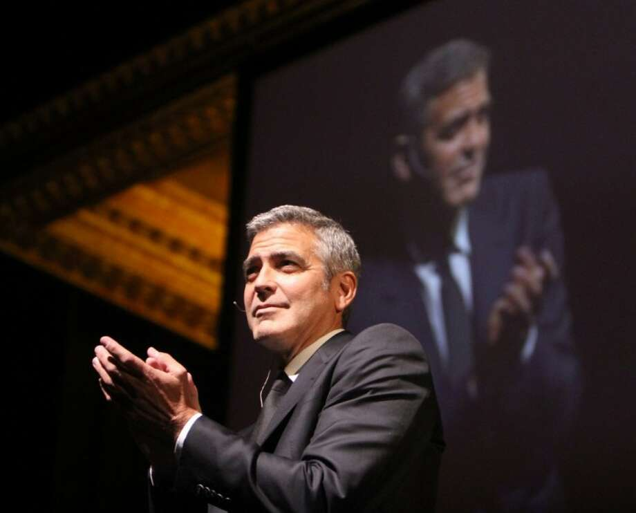 Actor George Clooney discussed his early childhood, current life, politics and his work raising awareness of the conflict in Darfur, during 'A Conversation with George Clooney,' part of the Brilliant Lecture Series, at the Wortham Center in downtown Houston, on May 3, 2012.