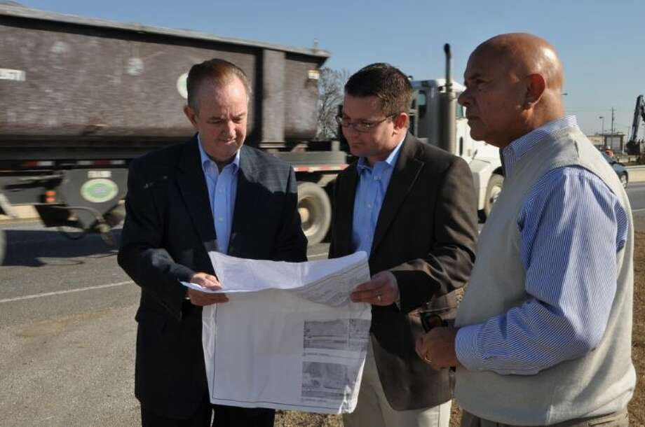Pasadena Mayor Johnny Isbell, Harris County Precinct 2 Commissioner Jack Morman and Pct. 2 Senior Director of Operations & CIP Jack Rodriguez review plans for the Fairmont improvement and expansion project. Photo: Courtesy City Of Pasadena