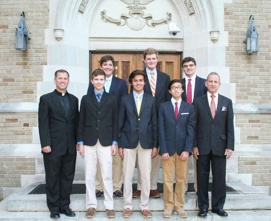 Fairfield College Preparatory School President Rev. Thomas Simisky (front left) stands with the school's National Merit Scholarship Program semifinalist Jonathan Siveyer, commended students Grant Ballesteros and Junlin Mo and school Principal Robert Perrotta. In the back row are commended students Brendan Flynn (left), Tom Paul and Ben Martinez. The seniors at the Fairfield, Conn. school received their honors this fall. Photo: Fairfield College Preparatory School / Contributed Photo / Fairfield Citizen