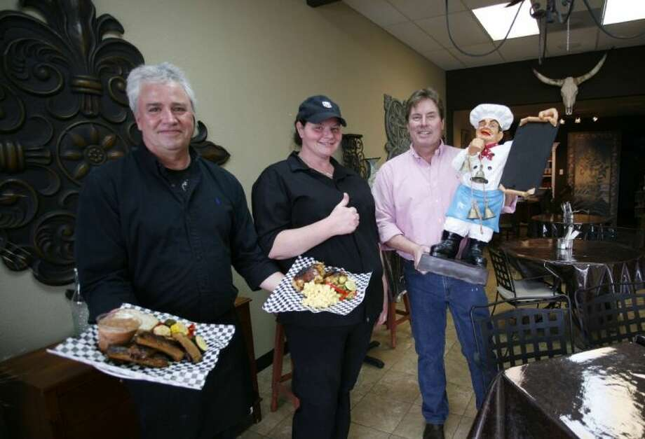 From left, Paul Bullard, Amanda Bullard and Craig Brewer recently opened The Kitchen Diner & Emporium in Rosehill just west of Tomball. The diner serves Bullard's own spin on Texas barbecue and comfort style cuisine.