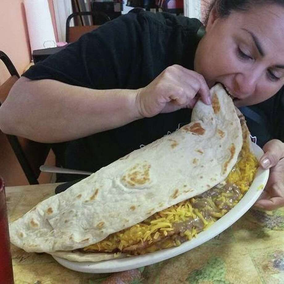 Chachos Tacos in Corpus Christi challenges customers to eat a nearly 4-pound taco in 10 minutes. Photo: Norma Toro