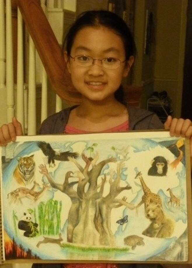 "Stacy Tao, a Quail Valley GT Academy seventh-grade student, with her painting ""Life in the Forests."" Photo: Submitted Photo"