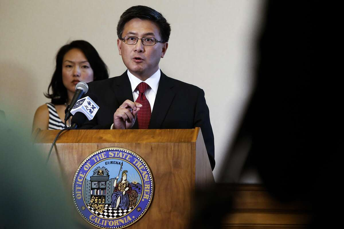 San Francisco Supervisor Jane Kim joins California State Treasurer John Chiang as he announced sanctions against Wells Fargo Bank after their admission that thousands of its bank employees opened over two million fraudulent consumer accounts. The announcement came during a press conference at City Hall in San Francisco, California on Wed. Sept. 28, 2016.
