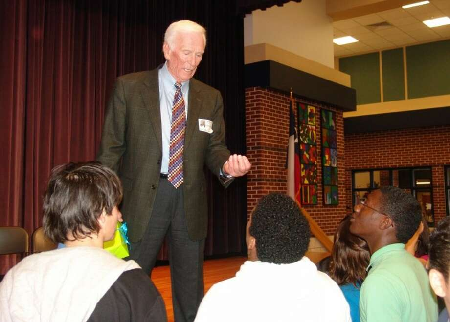 "Retired astronaut Gene Cernan chats with students at Berry Miller Junior High School in Pearland about his experience in space and their opportuity to ""reach for the stars."""