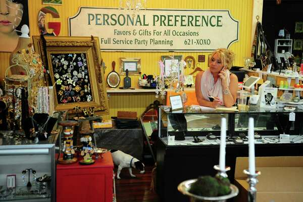 Lynne Burnham, owner of Ro and Bette's Attic, talks to a customer at the shop on Bank Street in Seymour. The Seymour Board of Selectmen recently voted to disband the Downtown Action Committee, which was formed to help enhance the downtown area and spur growth in businesses located there.