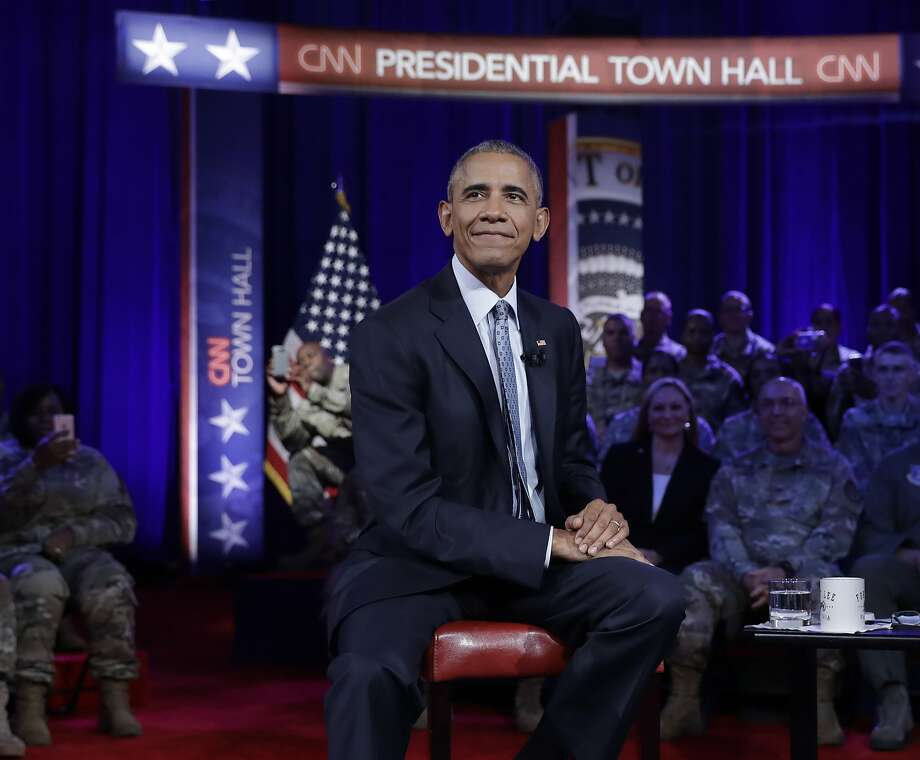 President Barack Obama pauses during a break in taping of a CNN town hall meeting with CNN news anchor Jake Tapper, Wednesday, Sept. 28, 2016, in Fort Lee, Va., with members of the military community. (AP Photo/Carolyn Kaster) Photo: Carolyn Kaster, Associated Press
