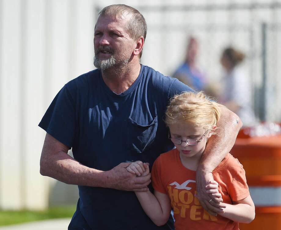Joey Taylor walks with his daughter Josie Taylor after picking her up at Oakdale Baptist Church on Wednesday, Sept. 28, 2016, in Townville, S.C. Students were evacuated to the church following a shooting at Townville Elementary School. A teenager opened fire at the South Carolina elementary school Wednesday.  (AP Photo/Rainier Ehrhardt) Photo: Rainier Ehrhardt, Associated Press